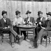 Albert Pauly, John Roeser, Bill Pauly, Frank Lenardo and unidentified  person playing cards. circa 1915