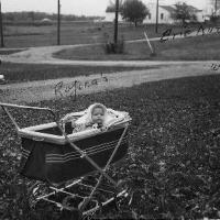 Susan Rojina in baby carriage - October 1957