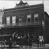 L.M. Weller store and residence with hearse in front - 1912