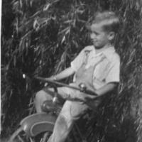 Dick Vogel on tricycle - circa unknown