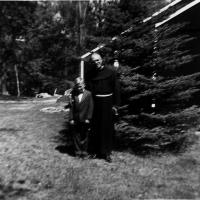 Fr. Herbert Diethelm, pastor at St. Hubert's with Craig Bongard - 1953