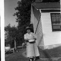 Elizabeth (Schlenk) Rettler standing in the back of her home - circa early 1950's